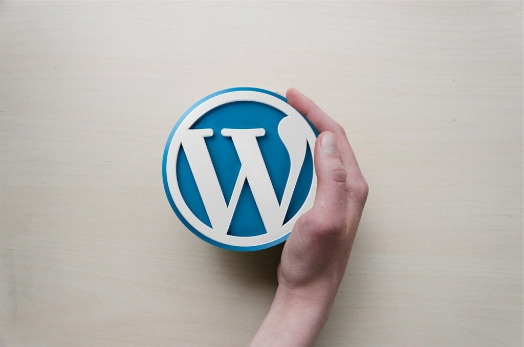 Wordpress logo with a hand